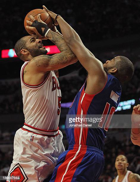 Carlos Boozer of the Chicago Bulls is fouled while shooting by Greg Monroe of the Detroit Pistons at the United Center on January 9 2012 in Chicago...