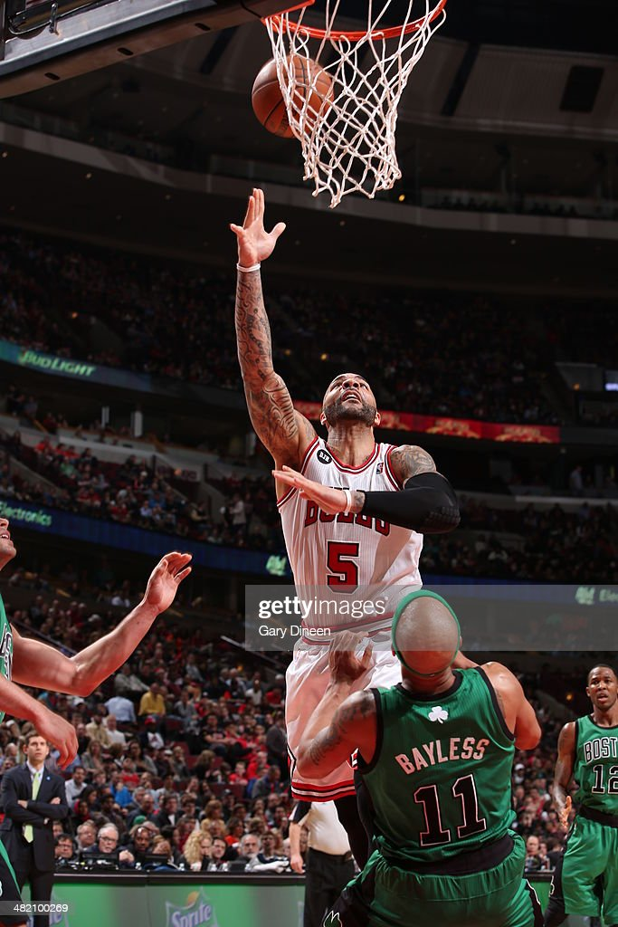 Carlos Boozer #5 of the Chicago Bulls lays the ball in the basket during the game against the Boston Celtics on March 31, 2014 at the United Center in Chicago, Illinois.