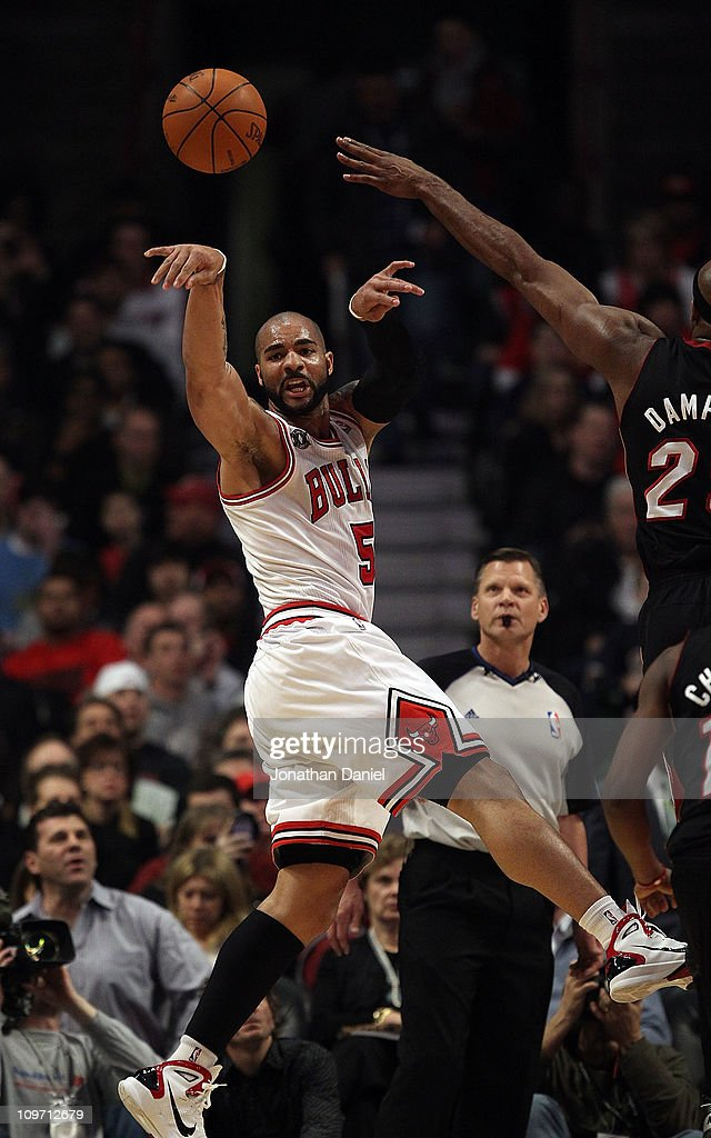 <a gi-track='captionPersonalityLinkClicked' href=/galleries/search?phrase=Carlos+Boozer&family=editorial&specificpeople=201638 ng-click='$event.stopPropagation()'>Carlos Boozer</a> #5 of the Chicago Bulls leaps to pass against the Miami Heat at the United Center on February 24, 2011 in Chicago, Illinois. The Bulls defeated the Heat 93-89.