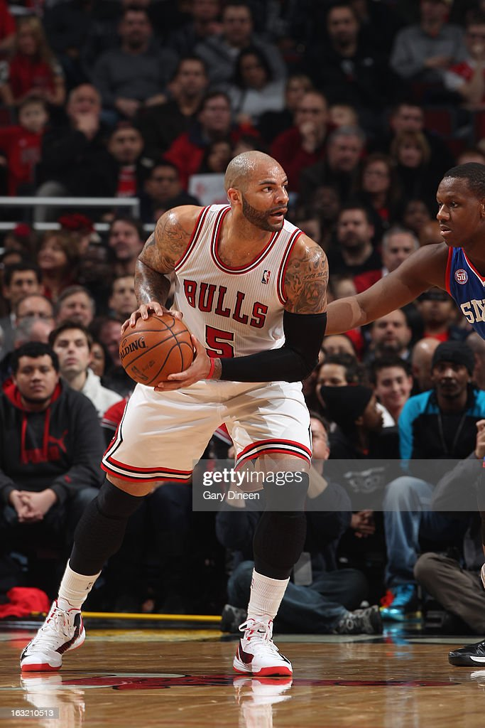 <a gi-track='captionPersonalityLinkClicked' href=/galleries/search?phrase=Carlos+Boozer&family=editorial&specificpeople=201638 ng-click='$event.stopPropagation()'>Carlos Boozer</a> #5 of the Chicago Bulls looks to drive to the basket against the Philadelphia 76ers on February 28, 2013 at the United Center in Chicago, Illinois.