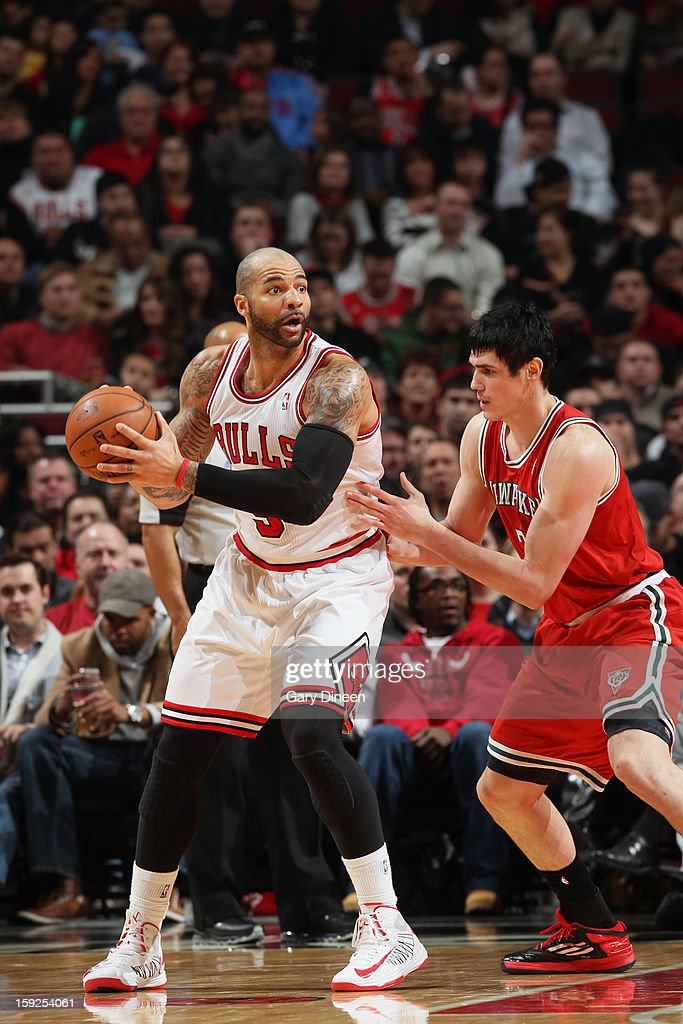 <a gi-track='captionPersonalityLinkClicked' href=/galleries/search?phrase=Carlos+Boozer&family=editorial&specificpeople=201638 ng-click='$event.stopPropagation()'>Carlos Boozer</a> #5 of the Chicago Bulls looks to pass the ball against the Milwaukee Bucks on January 9, 2013 at the United Center in Chicago, Illinois.