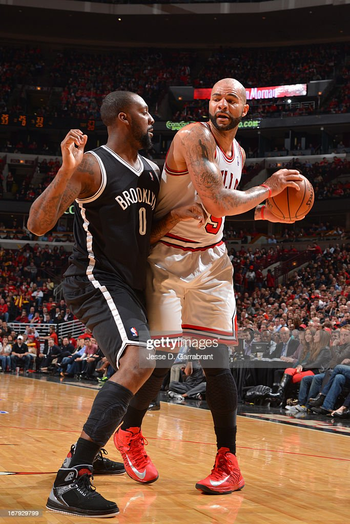 <a gi-track='captionPersonalityLinkClicked' href=/galleries/search?phrase=Carlos+Boozer&family=editorial&specificpeople=201638 ng-click='$event.stopPropagation()'>Carlos Boozer</a> #5 of the Chicago Bulls looks to pass the ball against the Brooklyn Nets in Game Three of the Eastern Conference Quarterfinals during the 2013 NBA Playoffs on April 25, 2013 at United Center in Chicago, Illinois.