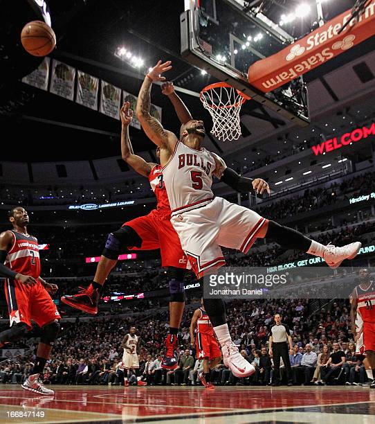 Carlos Boozer of the Chicago Bulls looses the ball after being fouled by Trevor Booker of the Washington Wizards at the United Center on April 17...