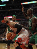 Carlos Boozer of the Chicago Bulls moves against Kevin Garnett of the Boston Celtics as Paul Pierce moves in at United Center on April 7 2011 in...