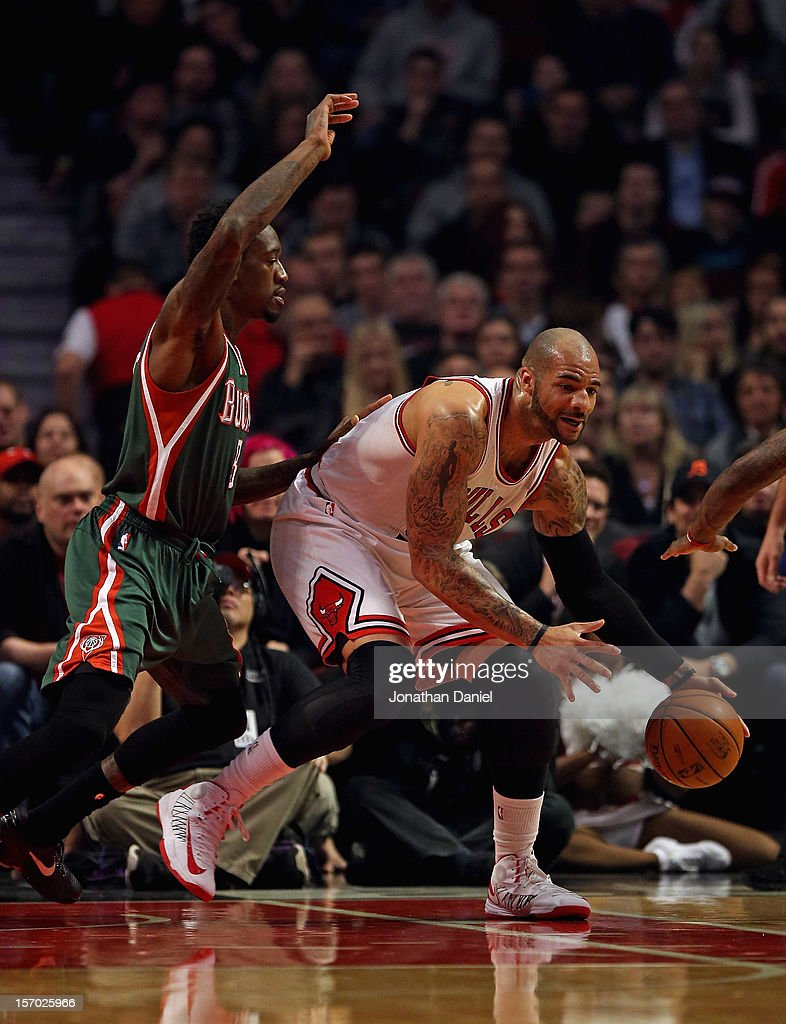 <a gi-track='captionPersonalityLinkClicked' href=/galleries/search?phrase=Carlos+Boozer&family=editorial&specificpeople=201638 ng-click='$event.stopPropagation()'>Carlos Boozer</a> #5 of the Chicago Bulls moves against Larry Sanders #8 of the Milwaukee Bucks at the United Center on November 26, 2012 in Chicago, Illinois. The Bucks defeated the Bulls 93-92.