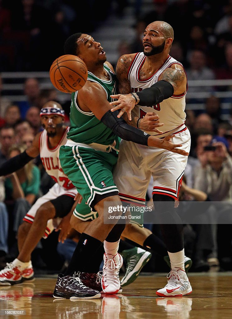 Carlos Boozer #5 of the Chicago Bulls passes the ball around Jared Sullinger #7 of the Boston Celtics at the United Center on November 12, 2012 in Chicago, Illinois.