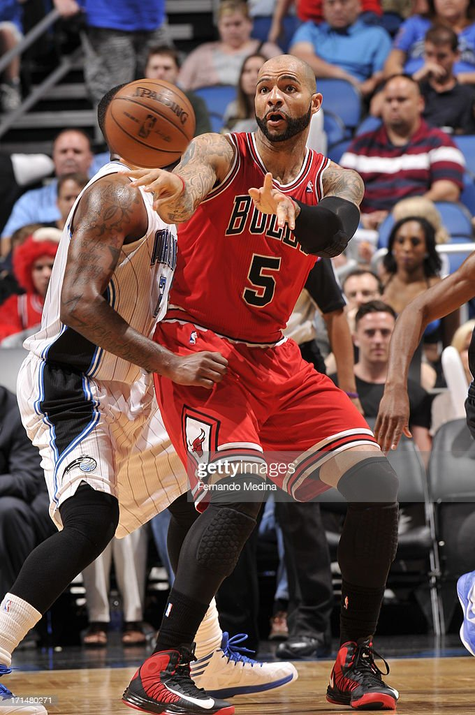 <a gi-track='captionPersonalityLinkClicked' href=/galleries/search?phrase=Carlos+Boozer&family=editorial&specificpeople=201638 ng-click='$event.stopPropagation()'>Carlos Boozer</a> #5 of the Chicago Bulls passes the ball during a game on April 15, 2013 at Amway Center in Orlando, Florida.