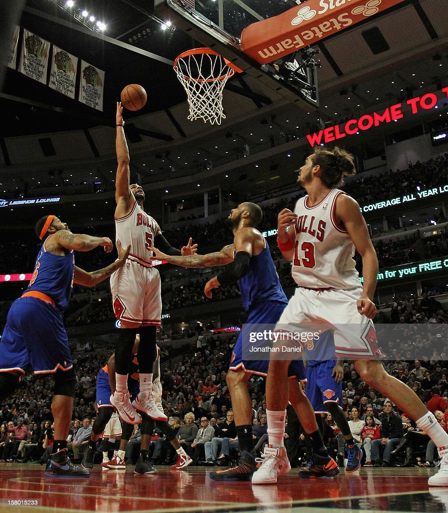 Carlos Boozer #5 of the Chicago Bulls puts up a shot between Rasheed Wallace #36 (L) and Tyson Chandler #6 of the New York Knicks at the United Center on December 8, 2012 in Chicago, Illinois. The Bulls defeated the Knicks 93-85.