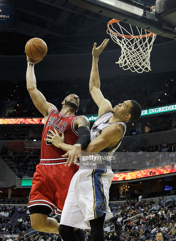 Carlos Boozer of the Chicago Bulls puts up a shot in front of JaVale McGee of the Washington Wizards at the Verizon Center in Washington on February...