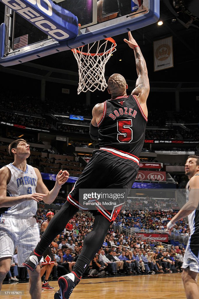 <a gi-track='captionPersonalityLinkClicked' href=/galleries/search?phrase=Carlos+Boozer&family=editorial&specificpeople=201638 ng-click='$event.stopPropagation()'>Carlos Boozer</a> #5 of the Chicago Bulls puts up the layup against the Orlando Magic during the game on January 2, 2013 at Amway Center in Orlando, Florida.