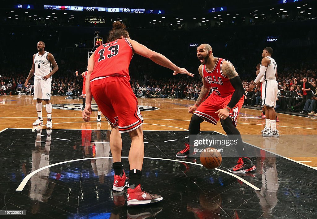 Carlos Boozer #5 of the Chicago Bulls (R) reacts after a slam dunk by Joakim Noah #13 (L) against the Brooklyn Nets during the second half of Game Two of the Eastern Conference Quarterfinals of the 2013 NBA Playoffs at the Barclays Center on April 22, 2013 in New York City. The Bulls defeated the Nets 90-82.