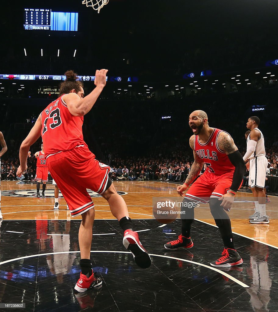 <a gi-track='captionPersonalityLinkClicked' href=/galleries/search?phrase=Carlos+Boozer&family=editorial&specificpeople=201638 ng-click='$event.stopPropagation()'>Carlos Boozer</a> #5 of the Chicago Bulls (R) reacts after a slam dunk by <a gi-track='captionPersonalityLinkClicked' href=/galleries/search?phrase=Joakim+Noah&family=editorial&specificpeople=699038 ng-click='$event.stopPropagation()'>Joakim Noah</a> #13 (L) against the Brooklyn Nets during the second half of Game Two of the Eastern Conference Quarterfinals of the 2013 NBA Playoffs at the Barclays Center on April 22, 2013 in New York City. The Bulls defeated the Nets 90-82.