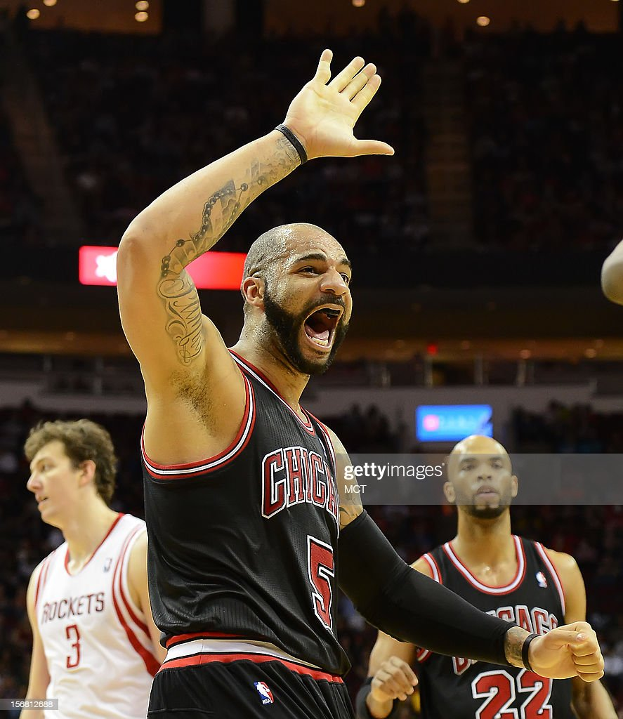 Carlos Boozer (5) of the Chicago Bulls reacts after a teammate scored and was fouled against the Houston Rockets in the second half of the Rockets' 93-89 victory on Wednesday, November 21, 2012, in Houston, Texas.