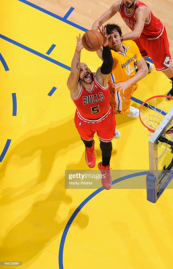 <a gi-track='captionPersonalityLinkClicked' href=/galleries/search?phrase=Carlos+Boozer&family=editorial&specificpeople=201638 ng-click='$event.stopPropagation()'>Carlos Boozer</a> #5 of the Chicago Bulls rebounds against <a gi-track='captionPersonalityLinkClicked' href=/galleries/search?phrase=Andrew+Bogut&family=editorial&specificpeople=207105 ng-click='$event.stopPropagation()'>Andrew Bogut</a> #12 of the Golden State Warriors on March 15, 2013 at Oracle Arena in Oakland, California.