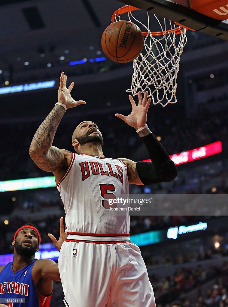 Carlos Boozer #5 of the Chicago Bulls rebounds against the Detroit Pistons at the United Center on April 11, 2014 in Chicago, Illinois. The Bulls defeated the Pistons 106-98.