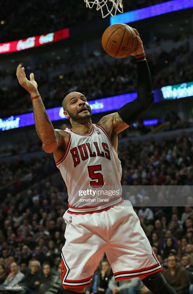 Carlos Boozer #5 of the Chicago Bulls rebounds against the Los Angeles Lakers at the United Center on January 21, 2013 in Chicago, Illinois. The Bulls defeated the Lakers 95-83.