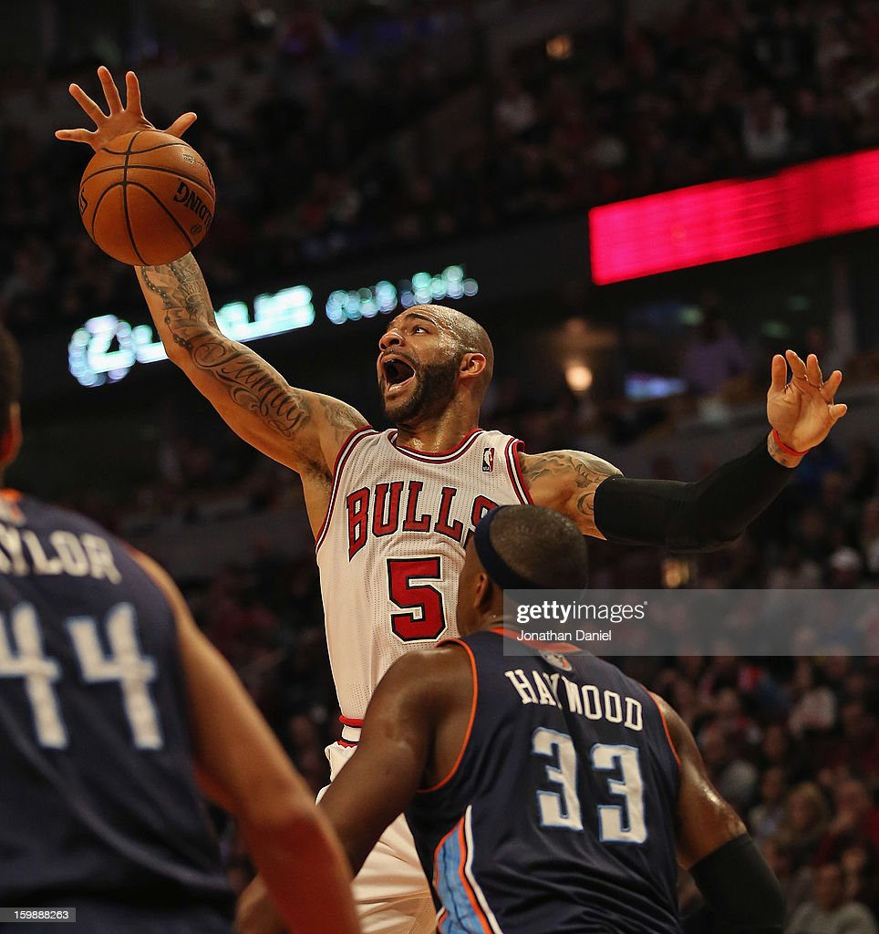 Carlos Boozer #5 of the Chicago Bulls rebounds over Brendan Haywood #33 of the Charlotte Bobcats at the United Center on December 31, 2012 in Chicago, Illinois. The Bobcats defeated the Bulls 91-81.