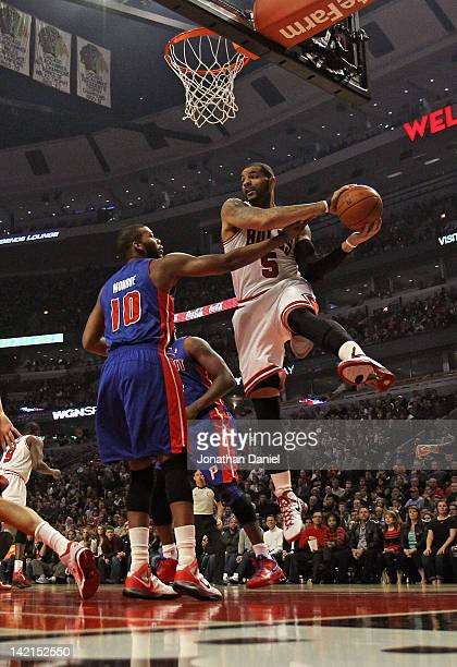 Carlos Boozer of the Chicago Bulls rebounds over Greg Monroe of the Detroit Pistons at the United Center on March 30 2012 in Chicago Illinois NOTE TO...