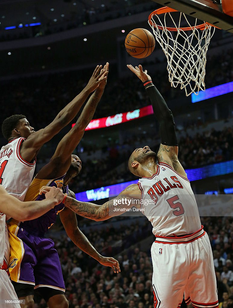 <a gi-track='captionPersonalityLinkClicked' href=/galleries/search?phrase=Carlos+Boozer&family=editorial&specificpeople=201638 ng-click='$event.stopPropagation()'>Carlos Boozer</a> #5 of the Chicago Bulls rebounds over teammate <a gi-track='captionPersonalityLinkClicked' href=/galleries/search?phrase=Jimmy+Butler+-+Basketballer&family=editorial&specificpeople=9860567 ng-click='$event.stopPropagation()'>Jimmy Butler</a> #21 and Earl Clark #6 of the Los Angeles Lakers at the United Center on January 21, 2013 in Chicago, Illinois. The Bulls defeated the Lakers 95-83.