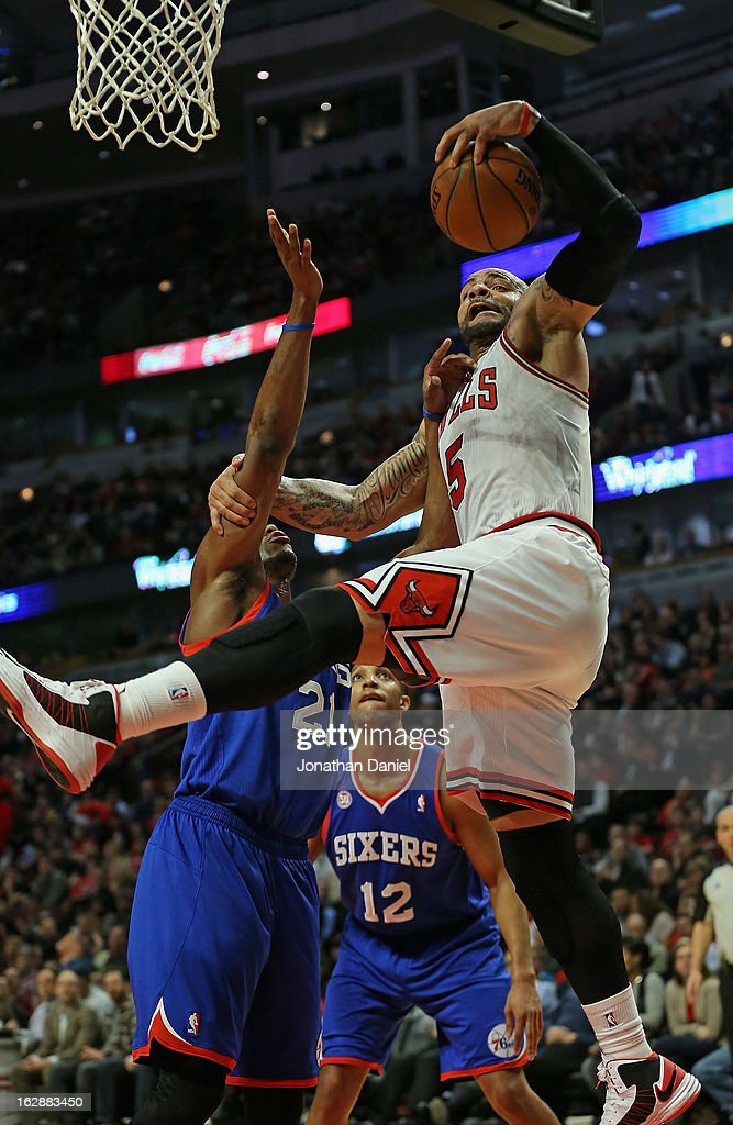 <a gi-track='captionPersonalityLinkClicked' href=/galleries/search?phrase=Carlos+Boozer&family=editorial&specificpeople=201638 ng-click='$event.stopPropagation()'>Carlos Boozer</a> #5 of the Chicago Bulls rebounds over <a gi-track='captionPersonalityLinkClicked' href=/galleries/search?phrase=Thaddeus+Young&family=editorial&specificpeople=3847270 ng-click='$event.stopPropagation()'>Thaddeus Young</a> #21 of the Phildelphia 76ers at the United Center on February 28, 2013 in Chicago, Illinois. The Bulls defeated the 76ers 93-82.