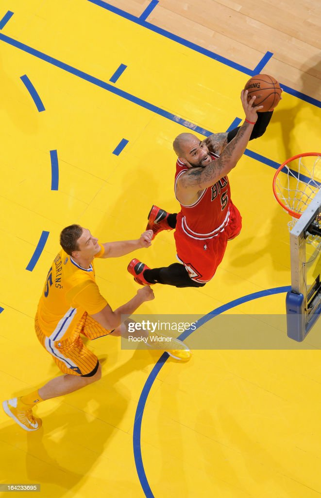 <a gi-track='captionPersonalityLinkClicked' href=/galleries/search?phrase=Carlos+Boozer&family=editorial&specificpeople=201638 ng-click='$event.stopPropagation()'>Carlos Boozer</a> #5 of the Chicago Bulls shoots against <a gi-track='captionPersonalityLinkClicked' href=/galleries/search?phrase=Andris+Biedrins&family=editorial&specificpeople=204473 ng-click='$event.stopPropagation()'>Andris Biedrins</a> #15 of the Golden State Warriors on March 15, 2013 at Oracle Arena in Oakland, California.