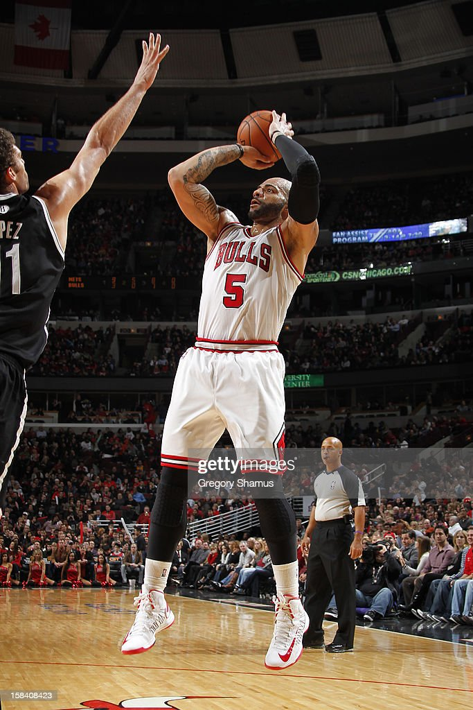 <a gi-track='captionPersonalityLinkClicked' href=/galleries/search?phrase=Carlos+Boozer&family=editorial&specificpeople=201638 ng-click='$event.stopPropagation()'>Carlos Boozer</a> #5 of the Chicago Bulls shoots against <a gi-track='captionPersonalityLinkClicked' href=/galleries/search?phrase=Brook+Lopez&family=editorial&specificpeople=3847328 ng-click='$event.stopPropagation()'>Brook Lopez</a> #11 of the Brooklyn Nets on December 15, 2012 at the United Center in Chicago, Illinois.