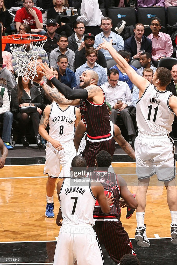 Carlos Boozer #5 of the Chicago Bulls shoots against Brook Lopez #11 of the Brooklyn Nets on April 4, 2013 at the Barclays Center in the Brooklyn borough of New York City.