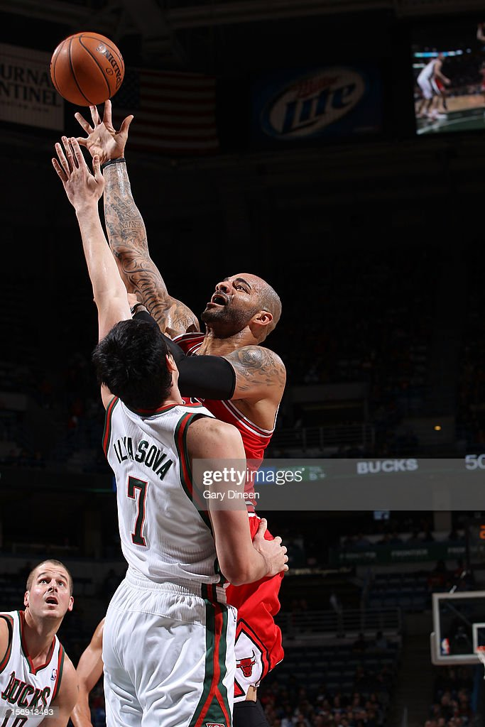 Carlos Boozer #5 of the Chicago Bulls shoots against Ersan Ilyasova #7 of the Milwaukee Bucks during the NBA game on November 24, 2012 at the BMO Harris Bradley Center in Milwaukee, Wisconsin.
