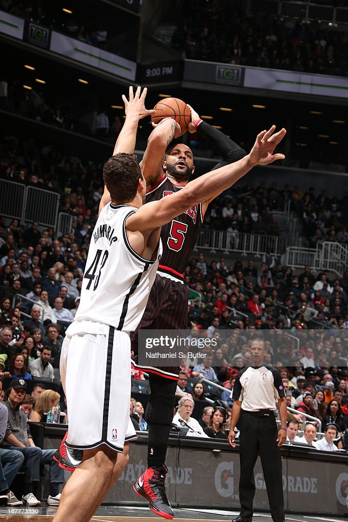 Carlos Boozer #5 of the Chicago Bulls shoots against Kris Humphries #43 of the Brooklyn Nets on April 4, 2013 at the Barclays Center in the Brooklyn borough of New York City.
