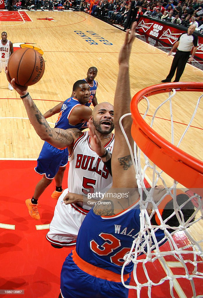 Carlos Boozer #5 of the Chicago Bulls shoots against Rasheed Wallace #36 of the New York Knicks on December 8, 2012 at the United Center in Chicago, Illinois.