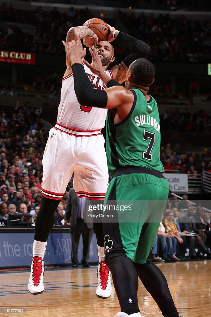 <a gi-track='captionPersonalityLinkClicked' href=/galleries/search?phrase=Carlos+Boozer&family=editorial&specificpeople=201638 ng-click='$event.stopPropagation()'>Carlos Boozer</a> #5 of the Chicago Bulls shoots against the Boston Celtics on March 31, 2014 at the United Center in Chicago, Illinois.