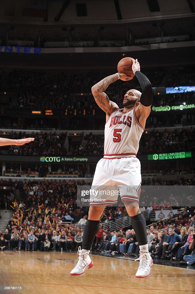 <a gi-track='captionPersonalityLinkClicked' href=/galleries/search?phrase=Carlos+Boozer&family=editorial&specificpeople=201638 ng-click='$event.stopPropagation()'>Carlos Boozer</a> #5 of the Chicago Bulls shoots against the Cleveland Cavaliers on December 21, 2013 at the United Center in Chicago, Illinois.