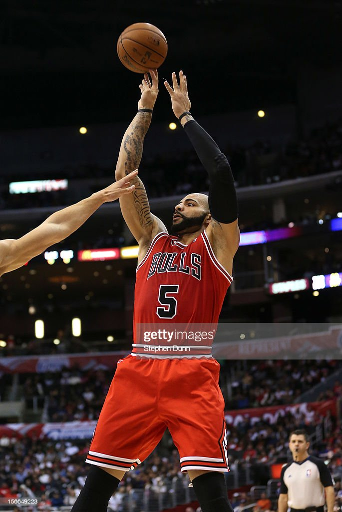 <a gi-track='captionPersonalityLinkClicked' href=/galleries/search?phrase=Carlos+Boozer&family=editorial&specificpeople=201638 ng-click='$event.stopPropagation()'>Carlos Boozer</a> #5 of the Chicago Bulls shoots against the Los Angeles Clippers at Staples Center on November 17, 2012 in Los Angeles, California. The Clippers won 101-80.