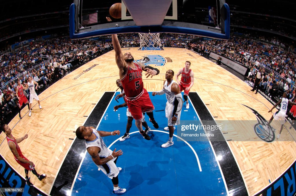<a gi-track='captionPersonalityLinkClicked' href=/galleries/search?phrase=Carlos+Boozer&family=editorial&specificpeople=201638 ng-click='$event.stopPropagation()'>Carlos Boozer</a> #5 of the Chicago Bulls shoots over <a gi-track='captionPersonalityLinkClicked' href=/galleries/search?phrase=Dwight+Howard&family=editorial&specificpeople=201570 ng-click='$event.stopPropagation()'>Dwight Howard</a> #12 and <a gi-track='captionPersonalityLinkClicked' href=/galleries/search?phrase=Jameer+Nelson&family=editorial&specificpeople=202057 ng-click='$event.stopPropagation()'>Jameer Nelson</a> #14 of the Orlando Magic on March 4, 2011 at the Amway Center in Orlando, Florida.