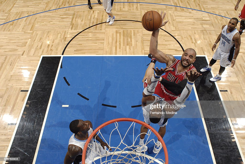 <a gi-track='captionPersonalityLinkClicked' href=/galleries/search?phrase=Carlos+Boozer&family=editorial&specificpeople=201638 ng-click='$event.stopPropagation()'>Carlos Boozer</a> #5 of the Chicago Bulls shoots over <a gi-track='captionPersonalityLinkClicked' href=/galleries/search?phrase=Dwight+Howard&family=editorial&specificpeople=201570 ng-click='$event.stopPropagation()'>Dwight Howard</a> #12 of the Orlando Magic on March 4, 2011 at the Amway Center in Orlando, Florida.