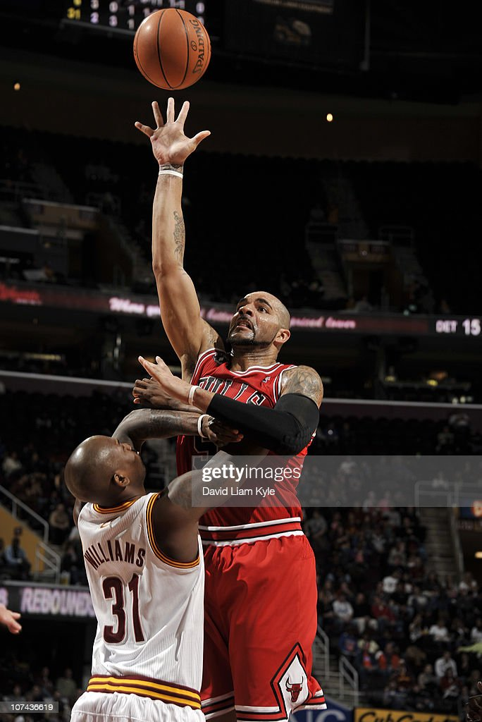<a gi-track='captionPersonalityLinkClicked' href=/galleries/search?phrase=Carlos+Boozer&family=editorial&specificpeople=201638 ng-click='$event.stopPropagation()'>Carlos Boozer</a> #5 of the Chicago Bulls shoots over <a gi-track='captionPersonalityLinkClicked' href=/galleries/search?phrase=Jawad+Williams&family=editorial&specificpeople=200696 ng-click='$event.stopPropagation()'>Jawad Williams</a> #31 of the Cleveland Cavaliers at The Quicken Loans Arena on December 8, 2010 in Cleveland, Ohio.