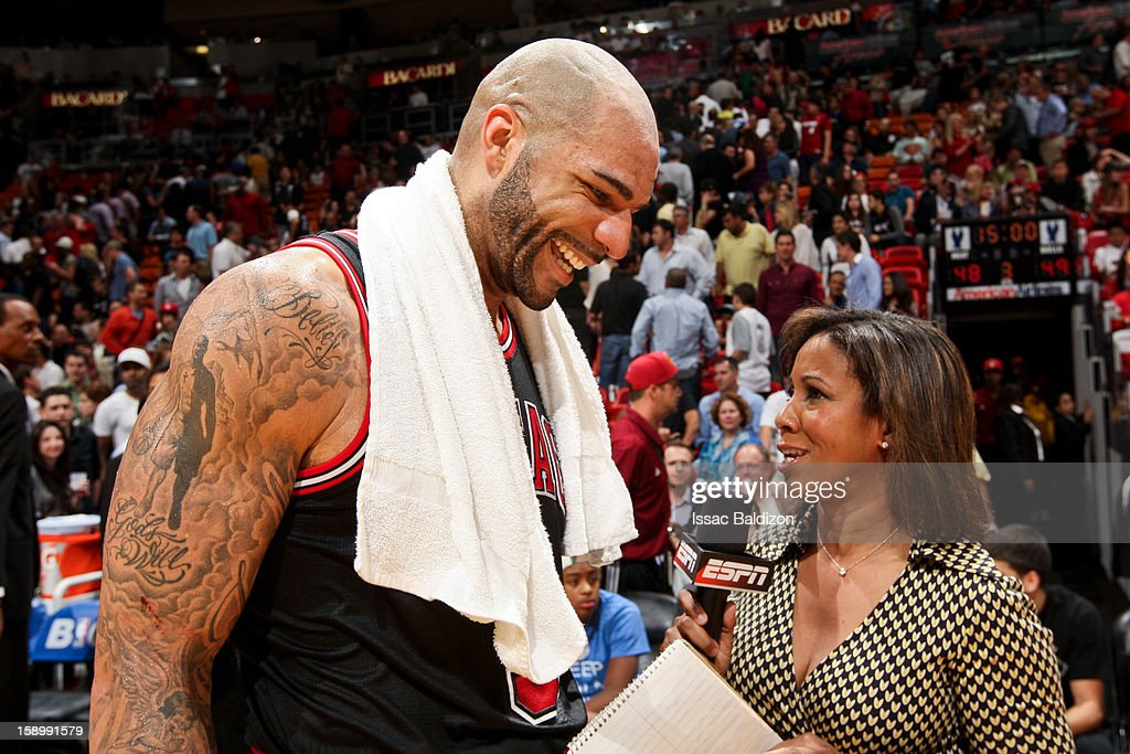 Carlos Boozer #5 of the Chicago Bulls smiles during an interview at halftime of his team's game against the Miami Heat on January 4, 2013 at American Airlines Arena in Miami, Florida.