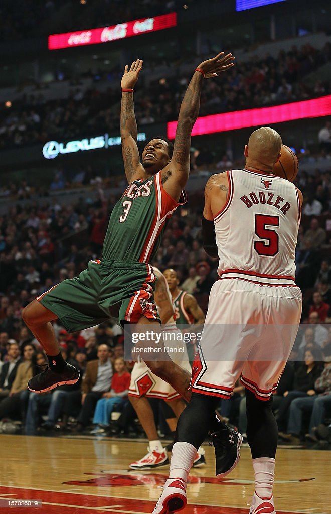 Carlos Boozer #5 of the Chicago Bulls strips the ball from Brandon Jennings #3 of the Milwaukee Bucks at the United Center on November 26, 2012 in Chicago, Illinois. The Bucks defeated the Bulls 93-92.