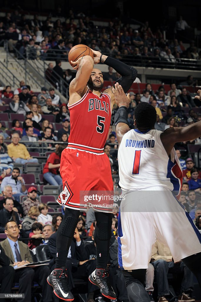 <a gi-track='captionPersonalityLinkClicked' href=/galleries/search?phrase=Carlos+Boozer&family=editorial&specificpeople=201638 ng-click='$event.stopPropagation()'>Carlos Boozer</a> #5 of the Chicago Bulls takes a jump shot against <a gi-track='captionPersonalityLinkClicked' href=/galleries/search?phrase=Andre+Drummond&family=editorial&specificpeople=7122456 ng-click='$event.stopPropagation()'>Andre Drummond</a> #1 of the Detroit Pistons on December 7, 2012 at The Palace of Auburn Hills in Auburn Hills, Michigan.