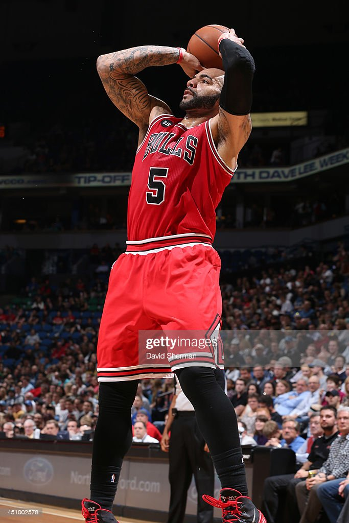 Carlos Boozer #5 of the Chicago Bulls takes a shot against the Minnesota Timberwolves during the game on April 9, 2014 at Target Center in Minneapolis, Minnesota.