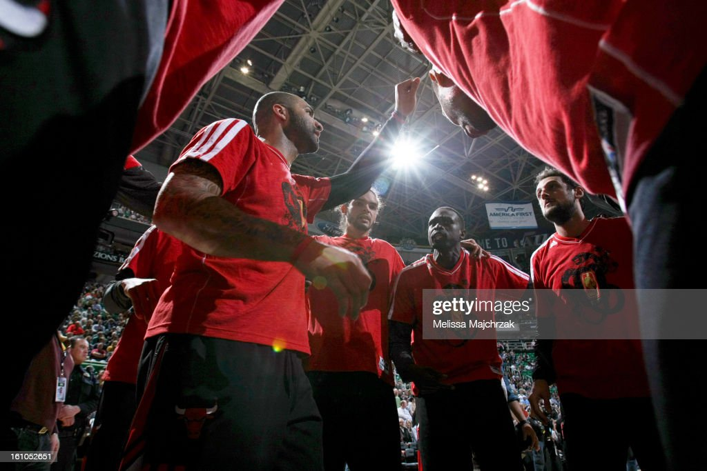 Carlos Boozer #5 of the Chicago Bulls, who are all wearing shirts in honor of the Chinese New Year, leads his teammates in a huddle before playing against the Utah Jazz at Energy Solutions Arena on February 08, 2013 in Salt Lake City, Utah.