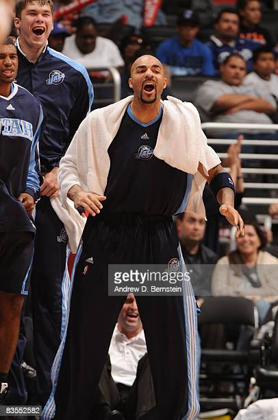 Carlos Boozer of the Utah Jazz cheers his team on from the bench against the Los Angeles Clippers at Staples Center on November 3 2008 in Los Angeles...
