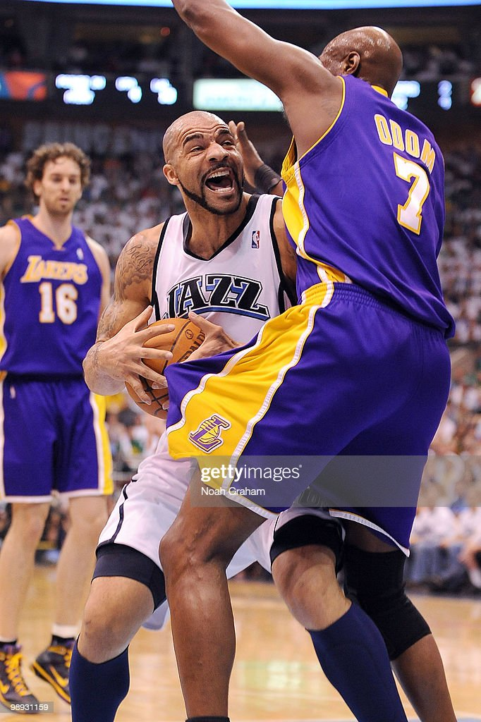 Carlos Boozer #5 of the Utah Jazz goes hard to the hoop against Lamar Odom #7 of the Los Angeles Lakers in Game Three of the Western Conference Semifinals during the 2010 NBA Playoffs at the EnergySolutions Arena on May 8, 2010 in Salt Lake City, Utah.