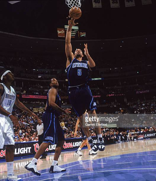 Carlos Boozer of the Utah Jazz lays up a shot during the game with the Denver Nuggets at Pepsi Center on November 4 2004 in Denver Colorado The...