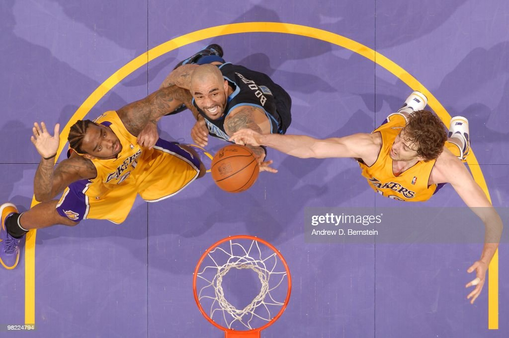 <a gi-track='captionPersonalityLinkClicked' href=/galleries/search?phrase=Carlos+Boozer&family=editorial&specificpeople=201638 ng-click='$event.stopPropagation()'>Carlos Boozer</a> #5 of the Utah Jazz reaches for a rebound between <a gi-track='captionPersonalityLinkClicked' href=/galleries/search?phrase=Josh+Powell&family=editorial&specificpeople=546627 ng-click='$event.stopPropagation()'>Josh Powell</a> #21 and <a gi-track='captionPersonalityLinkClicked' href=/galleries/search?phrase=Pau+Gasol&family=editorial&specificpeople=201587 ng-click='$event.stopPropagation()'>Pau Gasol</a> #16 of the Los Angeles Lakers at Staples Center on April 2, 2010 in Los Angeles, California.