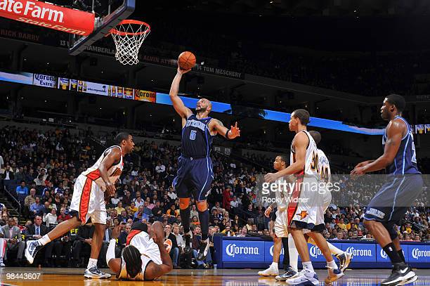 Carlos Boozer of the Utah Jazz scores inside against the Golden State Warriors on April 13 2010 at Oracle Arena in Oakland California NOTE TO USER...