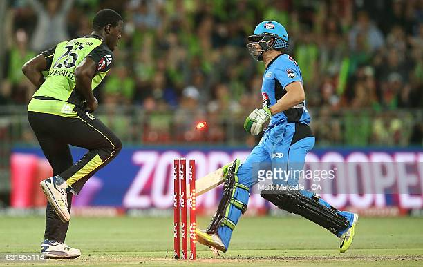 Carlos Braithwaite of the Thunder runs out Jake Lehmann of the Strikers during the Big Bash League match between the Sydney Thunder and the Adelaide...
