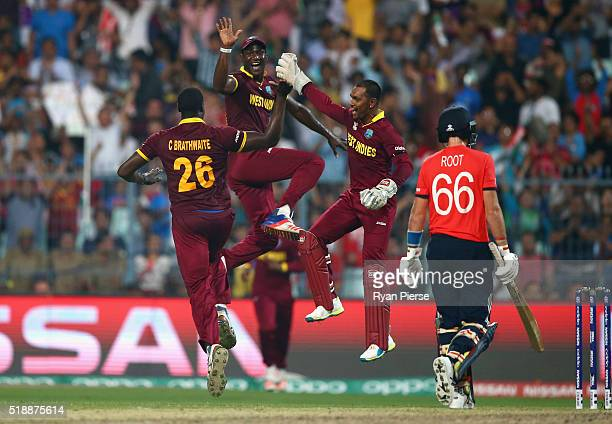 Carlos Brathwaite Darren Sammy and Denesh Ramdin of the West Indies celebrates after taking the wicket of Joe Root of England during the ICC World...