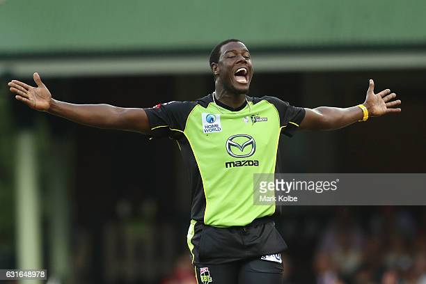 Carlos Brathwaite of the Thunder celebrates taking the wicket of Brad Haddin of the Sixers during the Big Bash League match between the Sydney Sixers...