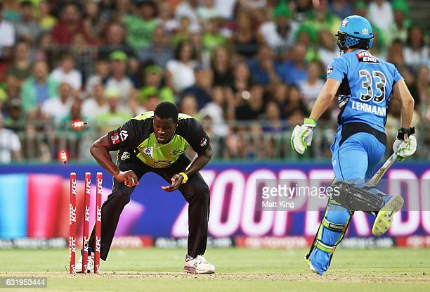 Carlos Brathwaite of the Thunder runs out Jake Lehmann of the Strikers during the Big Bash League match between the Sydney Thunder and the Adelaide...